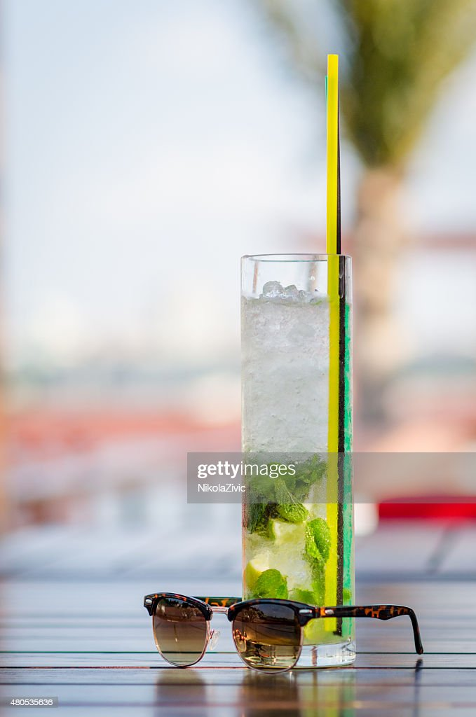 Mojito cocktail and sunglasses : Stock Photo