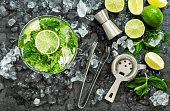 Mojito cocktail ingredients lime, mint leaves, ice. Drink making accessories
