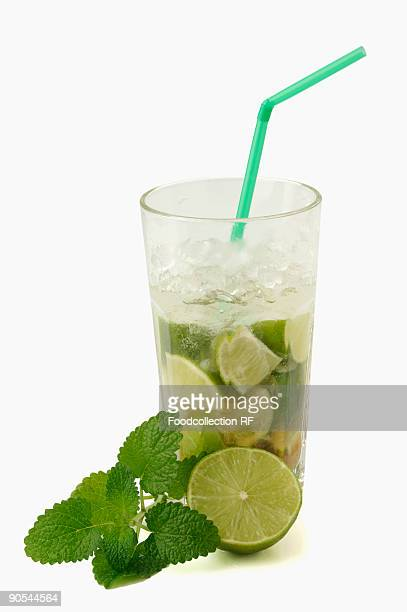 Mojito cocktail with fresh lime and mint, close up