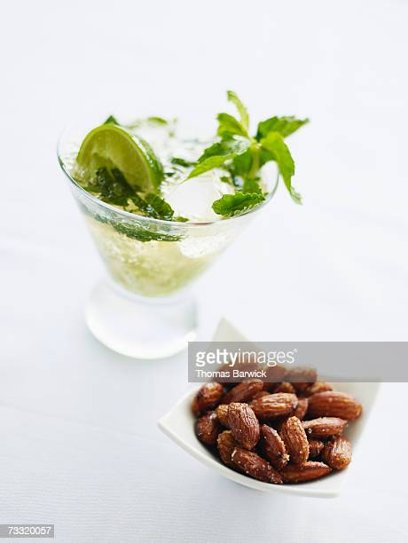 Mojito cocktail with fresh mint and lime with rasted almonds
