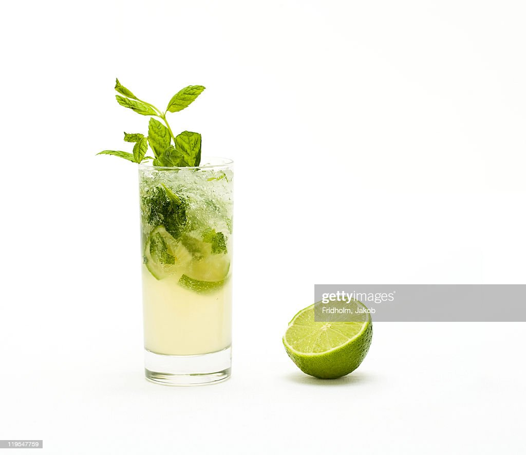 Mojito with fresh mint leaves and lime on crushed ice