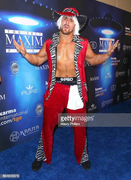 Mojo Rawley arrives at the 2017 Maxim Halloween Party at Los Angeles Center Studios on October 21 2017 in Los Angeles California