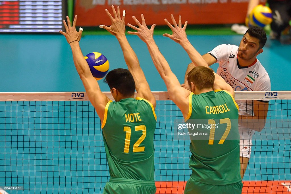 Mojtaba Mirzajanpour M. #12 of Iran spikes the ball during the Men's World Olympic Qualification game between Iran and Australia at Tokyo Metropolitan Gymnasium on May 28, 2016 in Tokyo, Japan.