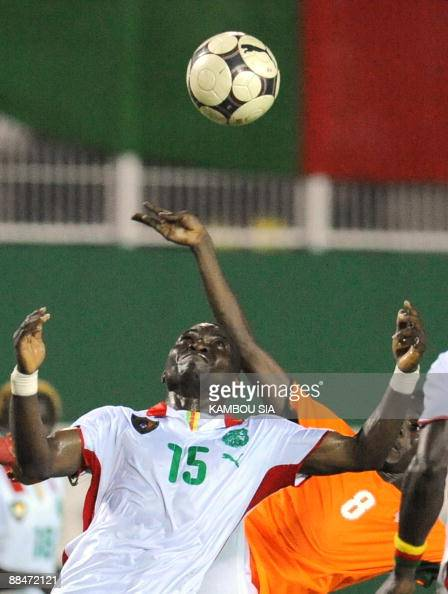 Mokake Marcus of Cameroon Lions and Kone Kouamatien of Ivory Coast Elephants vie during a friendly match on June 13 at the Houphouet Boigny stadium...