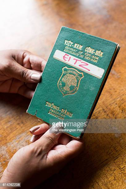 Moki Evans shows the passport she was issued in Vietnam as a baby in Washington DC on October 7 2016 Evans who was adopted in the US from Vietnam as...