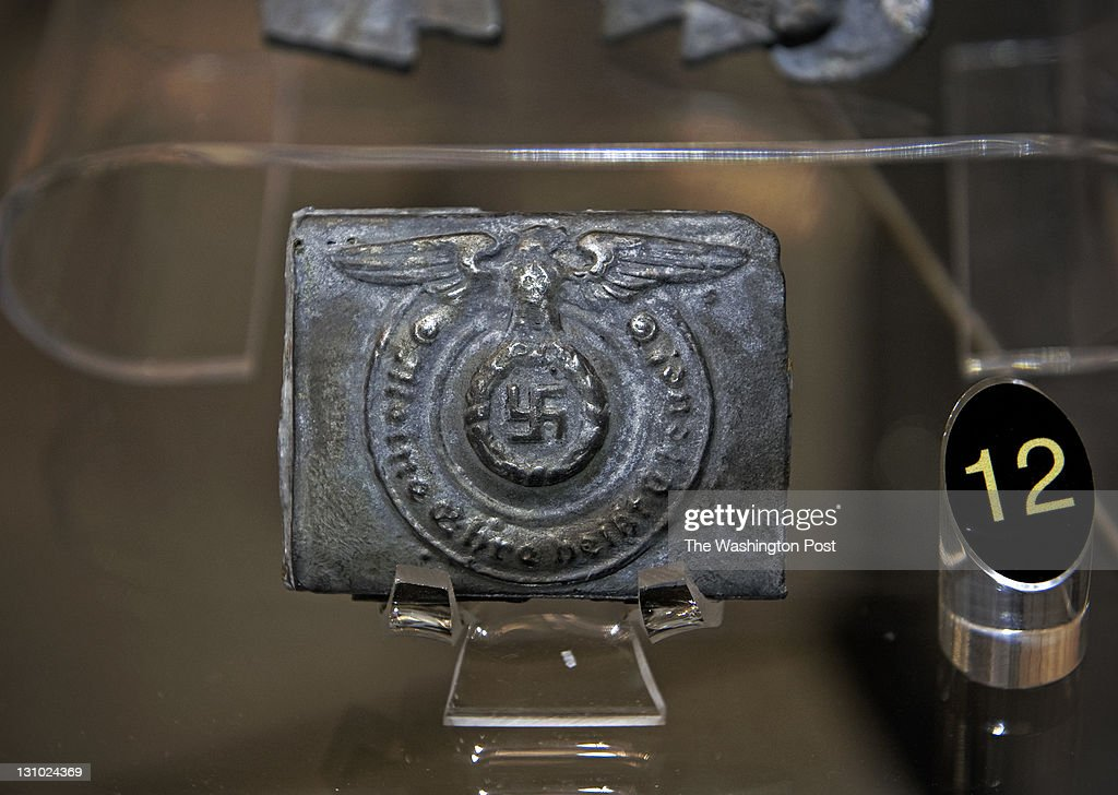 A mold made of boot polish tin by prisoners of war to replicate german clothing adornments is part of a new exhibit dedicated to the OSS has opened...