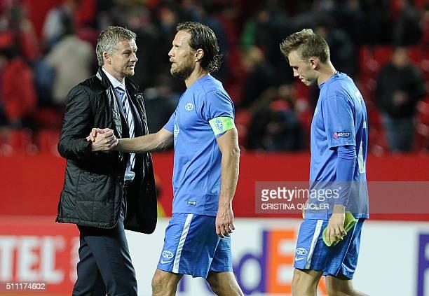 Molde FK's Norwegian coach Ole Gunnar Solskjaer shakes hands with Molde FK's Norwegian midfielder Daniel Hestad at the end of the UEFA Europa League...