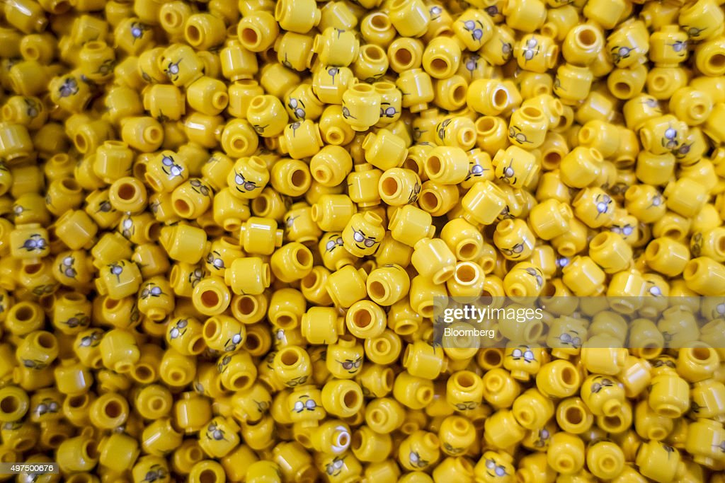 Molded head parts for toy figurines sit on the production line at the Lego A/S Factory in Kladno Czech Republic on Monday Nov 16 2015 Lego A/S...