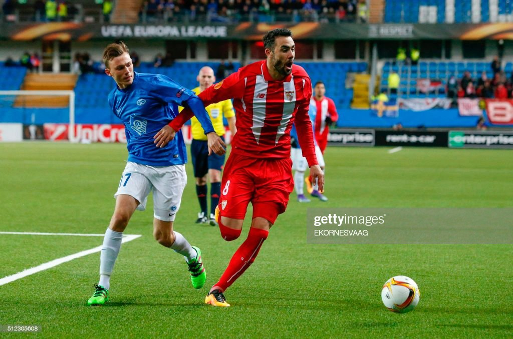Molde's Fredrik Aursnes and Sevilla's midfielder Iborra vie during the UEFA Europa League Round of 32 match football between Molde and Sevilla in...