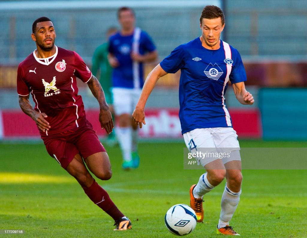 Molde's Martin Linnes vies for the ball with Rubin Kazan's Yann M'Vila during the UEFA Europa League qualifying football match Molde FK vs Rubin...