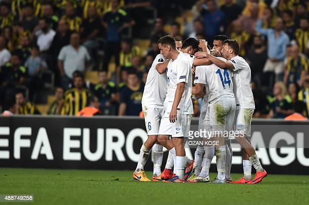 Molde's players celebrate after scoring a goal during the Europa League football match between Fenerbahce and Molde on September 17 2015 at the Ulker...