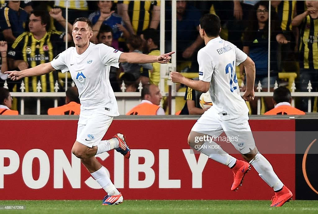 Molde's Tommy Hoiland celebrates with his teammates after scoring against Fenerbahce during the Europa League football match between Fenerbahce and...