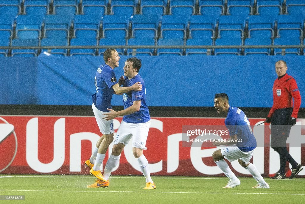 Molde's Vegard Forren (C) celebrates 2 - 0 with his teammates Mattias Mostrom (L) and Etzaz Hussain (R) during the UEFA Europa Leage football match Molde FK vs Celtic FC in Molde on October 22, 2015.
