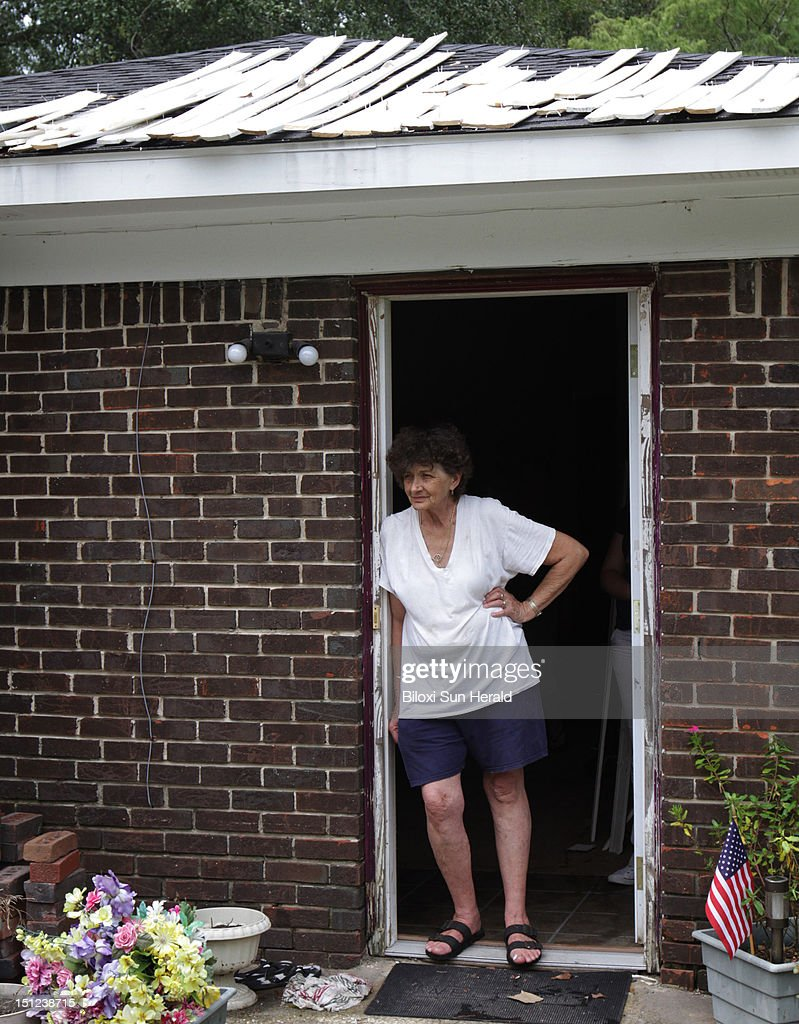 Molding dries on the roof above Betty Judge as she stands in the doorway of her house in the Helena community in Jackson County, Mississippi, on Tuesday, September 4, 2012 after Hurricane Isaac caused flooding in the area.