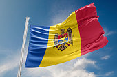 Moldova flag is waving at a beautiful and peaceful sky in day time while sun is shining. 3D Rendering