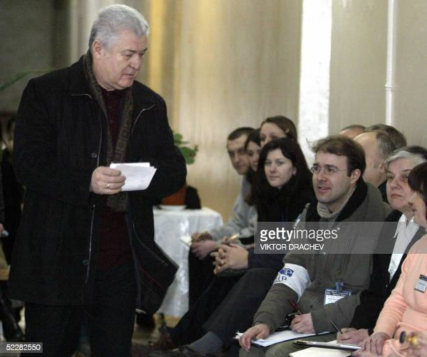 Moldovan President Vladimir Voronin passes by Organization for Security and Coooperation in Europe observers as he gets ready to cast his ballot at a...