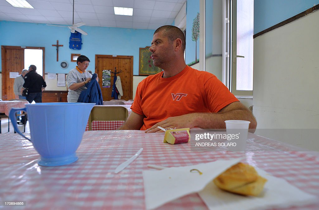 CARUSO ' Moldova's unemployed Alessandro looks on as he sits at the soup kitchen of Caritas a Catholic charity association at St Benedict parish in...