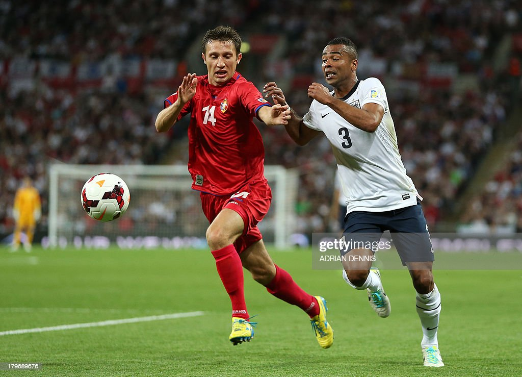Moldova's Vitalie Bordian (L) vies for the ball against England's Ashley Cole (R) during the World Cup 2014 Group H qualifying football match between England and Moldova at Wembley Stadium in north London, on September 6, 2013.