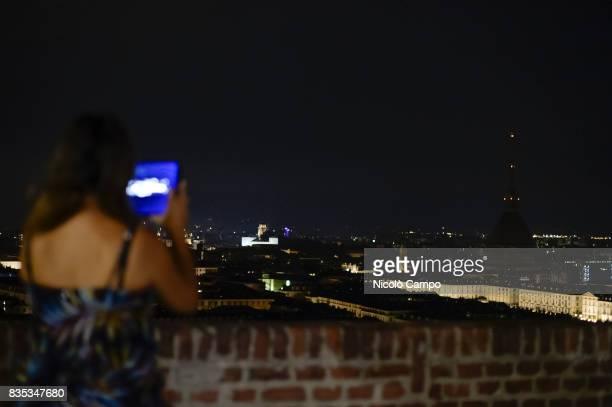 Mole Antonelliana main landmark of Turin turn its lights off in tribute to Barcelona attack victims