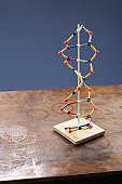 Molecule model on stained table