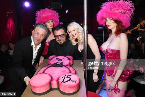 Molieres awarded actor Nicolas Briancon Muratt Atik and Joanna Atik pose with the birthday cake during Pink Paradise Club 15th Anniversary on March...