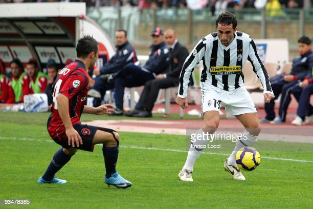 Molinaro Cristian of Juventus and Francesco Pisano of Cagliari during the Serie A match between Cagliari and Juventus at Stadio Sant'Elia on November...