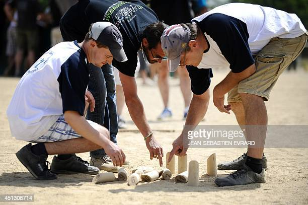 Molkky players count their score during a Molkky game on June 21 2014 in L'Hermitage western France The Molkky is a skittle game created by the...