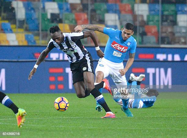 Molla Wague of Udinese Calcio competes with Marques Loureiro Allan of SSC Napoli during the Serie A match between Udinese Calcio and SSC Napoli at...
