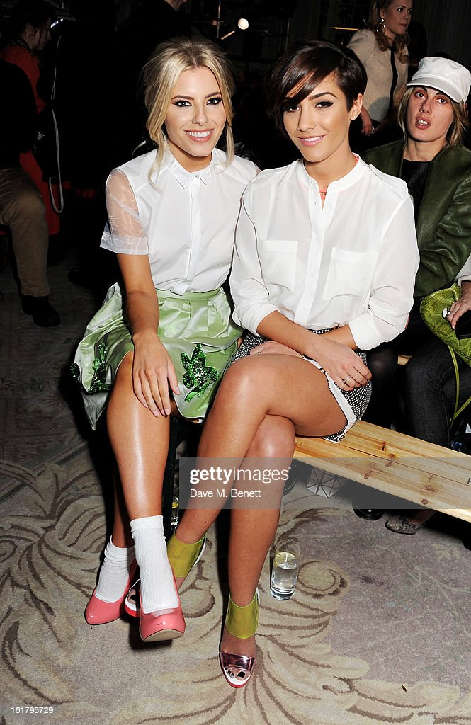 Mollie King (L) and Frankie Sandford attend the Moschino cheap&chic show during London Fashion Week Fall/Winter 2013/14 at The Savoy Hotel on February 16, 2013 in London, England.