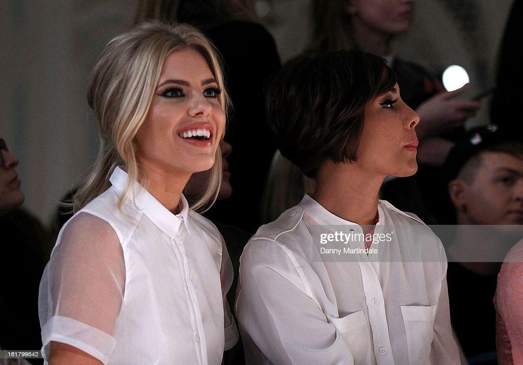Mollie King (L) and Frankie Sandford attends the Moschino cheap&chic show during London Fashion Week Fall/Winter 2013/14 at The Savoy Hotel on February 16, 2013 in London, England.