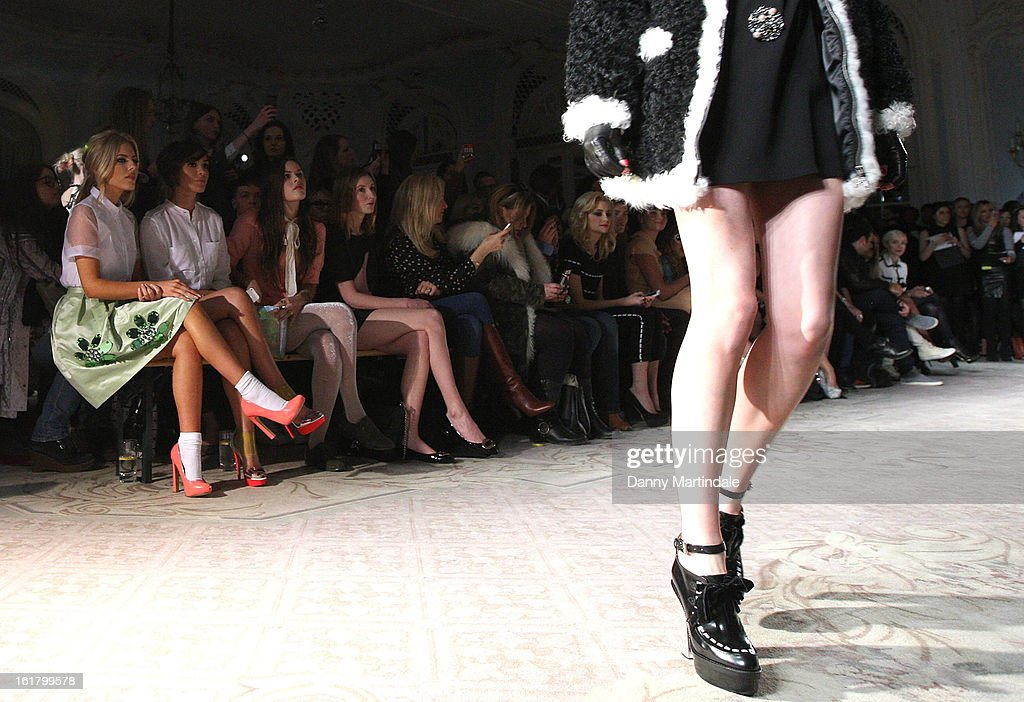 Mollie King and Frankie Sandford watch the Moschino cheap&chic show during London Fashion Week Fall/Winter 2013/14 at The Savoy Hotel on February 16, 2013 in London, England.