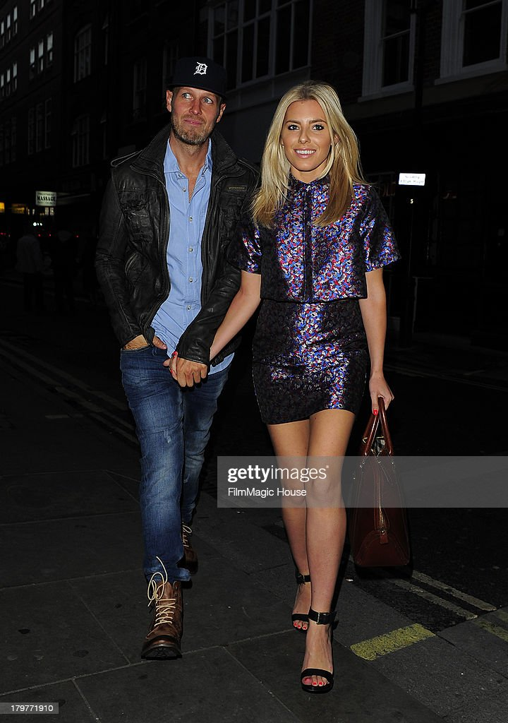 Mollie King and her Boyfriend Jordan Omley arrive at The Piccadilly Theatre to watch 'We Will Rock You' before heading to STK steak restaurant for dinner. on September 6, 2013 in London, England.