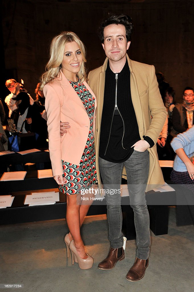 <a gi-track='captionPersonalityLinkClicked' href=/galleries/search?phrase=Mollie+King&family=editorial&specificpeople=5522262 ng-click='$event.stopPropagation()'>Mollie King</a> (L) and <a gi-track='captionPersonalityLinkClicked' href=/galleries/search?phrase=Nick+Grimshaw&family=editorial&specificpeople=4666727 ng-click='$event.stopPropagation()'>Nick Grimshaw</a> attend the Fashion East show during London Fashion Week Fall/Winter 2013/14 at TopShop Show Space on February 18, 2013 in London, England.