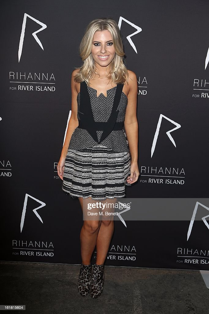 Mollie King arrives for the Rihanna for River Island fashion show during London Fashion Week Fall/Winter 2013/2014 at the Old Sorting Office on February 16, 2013 in London, England.