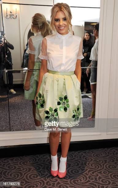 Mollie King attends the Moschino cheapchic show during London Fashion Week Fall/Winter 2013/14 at The Savoy Hotel on February 16 2013 in London...