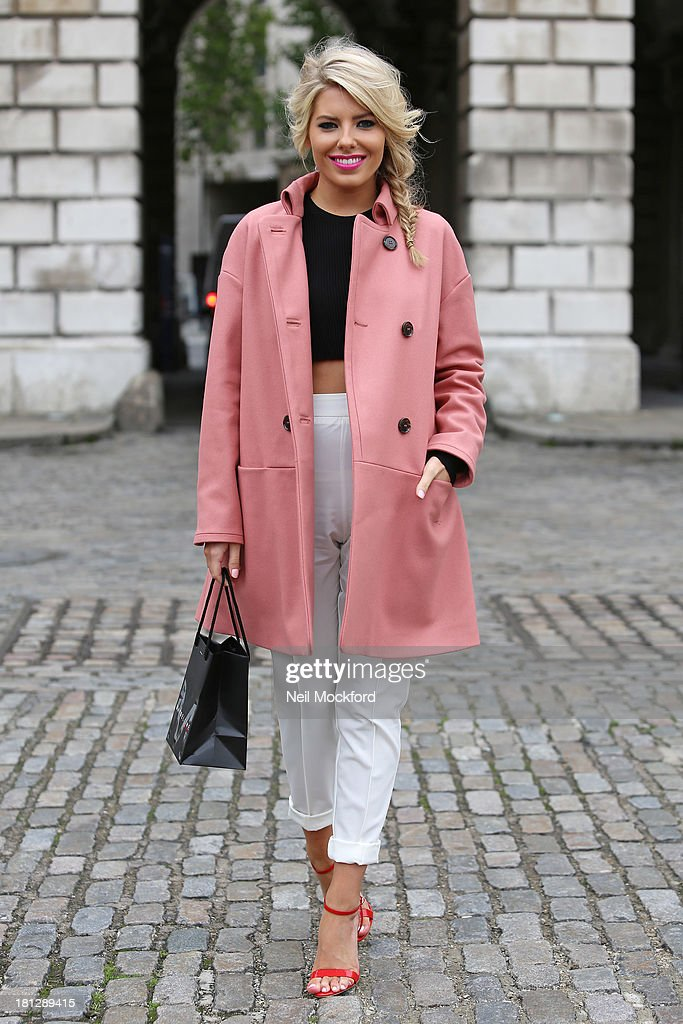 Mollie King poses at Somerset House with Maybelline for Vodafone London Fashion weekend on September 20, 2013 in London, England.