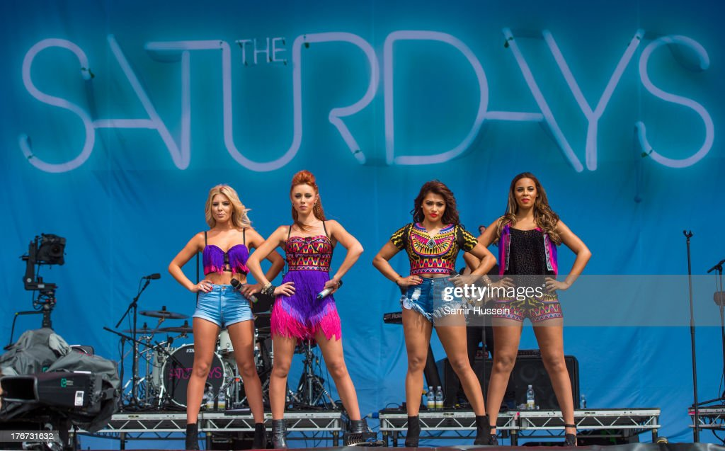 Mollie King, Una Healy, Vanessa White and Rochelle Humes of The Saturdays perform live on the Virgin Media Stage on day 2 of V Festival at Hylands Park on August 18, 2013 in Chelmsford, England.