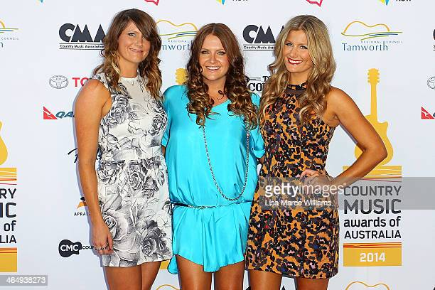 Mollie McClymont Brooke McClymont and Samantha McClymont of The McClymonts arrive at the 42nd Country Music Awards Of Australia on January 25 2014 in...