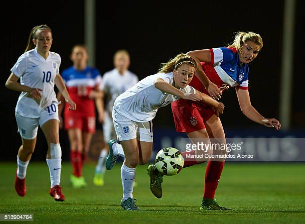 Mollie Rouse of England competes for the ball with Taylor Kornieck of USA during the women's U19 international friendly match between England U19 and...
