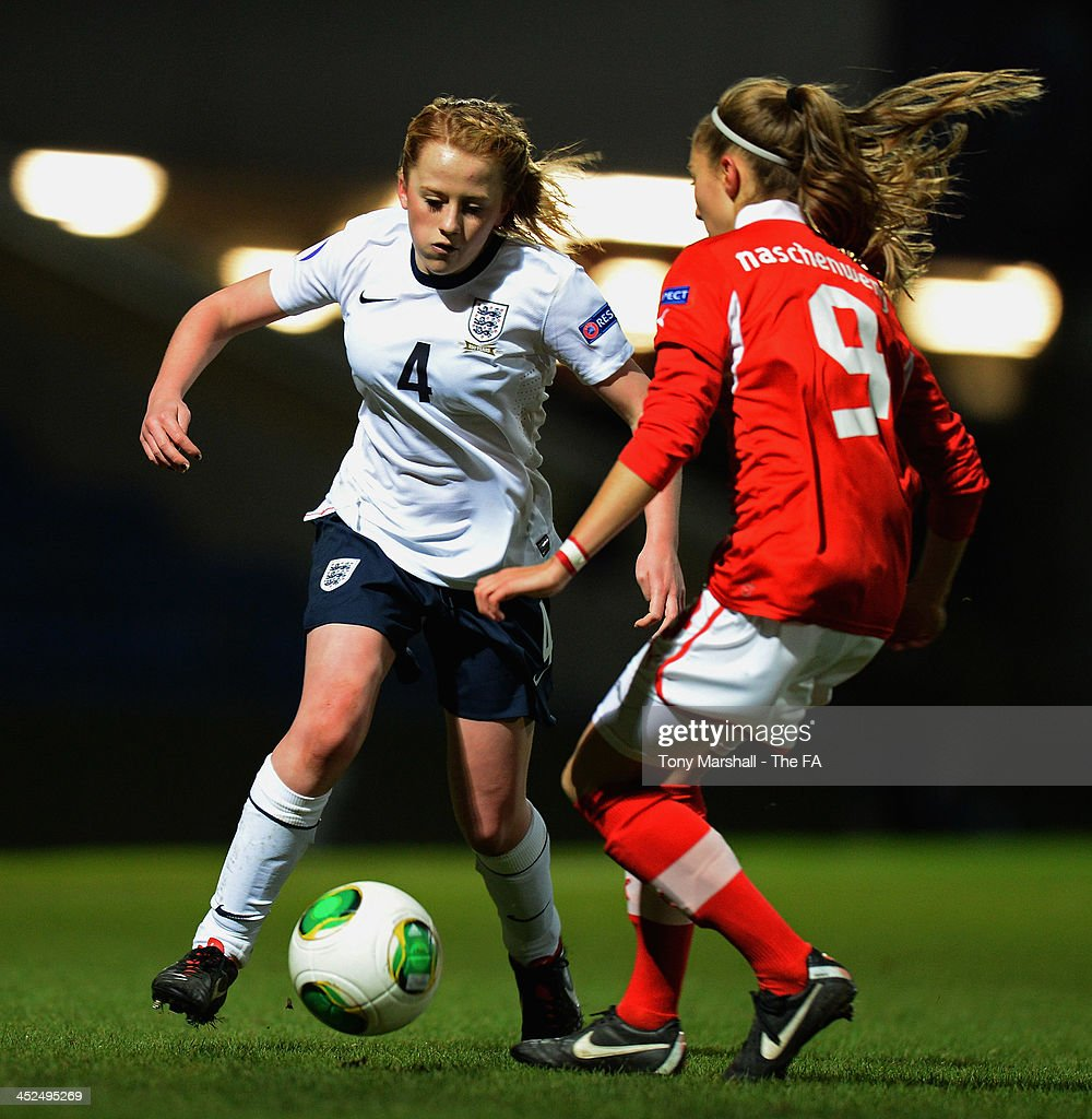 Mollie Rouse of England in action against Katharina Naschenweng of Austria during the UEFA Womens U17 Championship Finals match between England and Austria at Chesterfield FC Stadium on November 29, 2013 in Chesterfield, England.