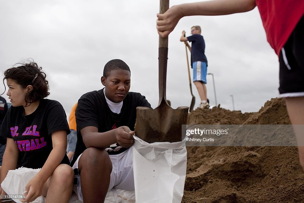 Mollie Russell Andre Statam Zack Williams and Paige Jenkins eighthgraders at Massac Junior High School fill sandbags where a swollen Ohio River has...