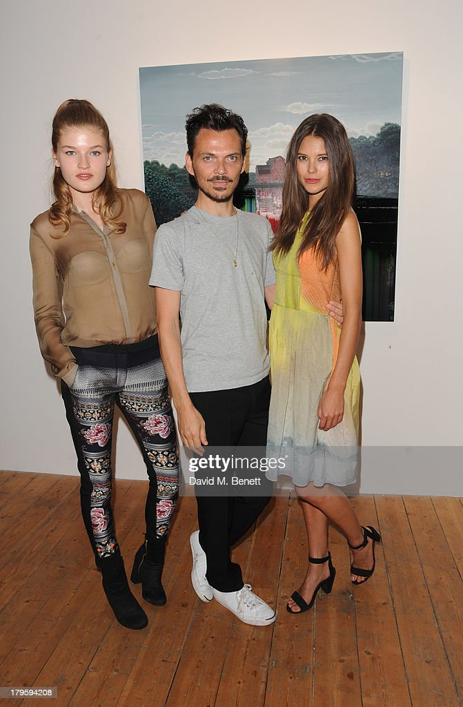 Mollie Smith, Matthew Williamson and Sarah Ann Macklin attends the VIP launch of the 'Hand To Earth' exhibition hosted by Matthew Williamson at Scream Gallery on September 5, 2013 in London, England.