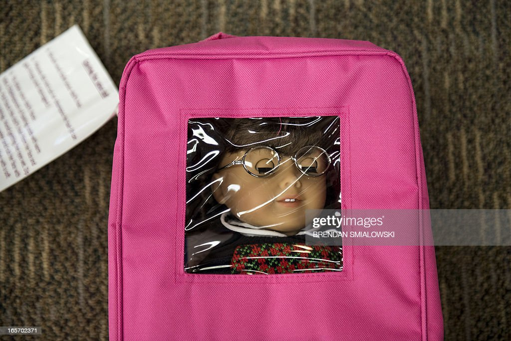 A Molly American Girl doll is seen in the case, tagged with cleaning and care instructions at the Arlington Library, using it to share with an accompanying book at the Cherrydale Branch of the Arlington Library April 4, 2013 in Arlington, Virginia. The Arlington library is expanding their offerings to include items beyond books including American Girl dolls. AFP PHOTO/Brendan SMIALOWSKI