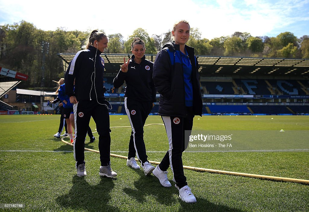 Molly Bartrip (R), Nia Jones (C) and Grace Maloney (L) walk off the pitch ahead of the WSL 1 match between Reading FC Women and Sunderland AFC Ladies on May 2, 2016 in High Wycombe, England.
