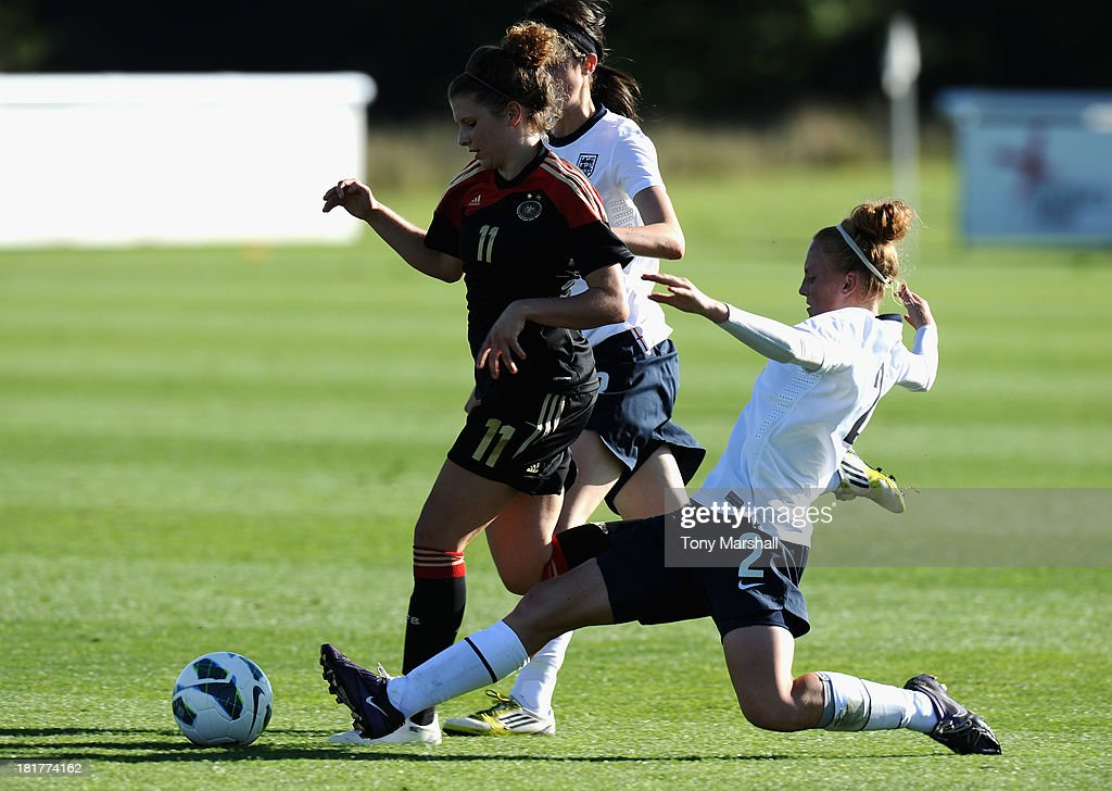 Molly Bartrip of England tackles Lina Burger of Germany during the Women's International Friendly match between England Under 19 Women and Germany Under 19 Women at St George's Park on September 22, 2013 in Burton upon Trent, England.