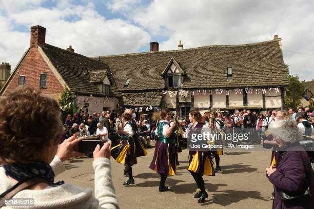 Molly dancers perform as people celebrate St George's Day and the official start of the asparagus season at the The Fleece Inn in Bretforton...