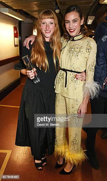 Molly Goddard winner of the British Emerging Talent award and Alexa Chung pose backstage at The Fashion Awards 2016 at Royal Albert Hall on December...