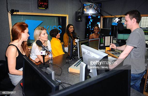 Molly King Frankie Sandford Vanessa White and Una Healy of The Saturdays with Live@Kiss Presenters Michael Lewis and Tinea Taylor at Kiss FM Studio's...