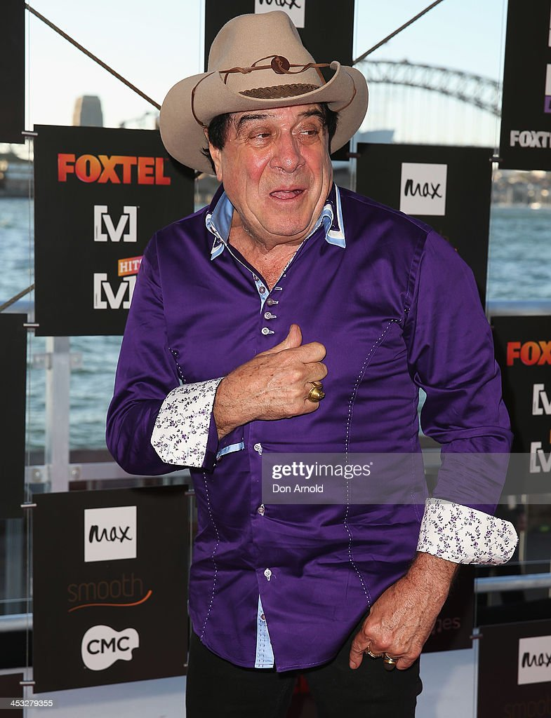 <a gi-track='captionPersonalityLinkClicked' href=/galleries/search?phrase=Molly+Meldrum&family=editorial&specificpeople=200714 ng-click='$event.stopPropagation()'>Molly Meldrum</a> arrives at the Foxtel Music Channels Summer Launch at the Botanic Gardens on December 3, 2013 in Sydney, Australia.
