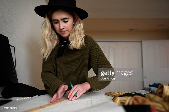 Molly OBrien 17 a senior at Rocky Mountain High School in Fort Collins drawing out patterns for her next collection in her basement OBrien operates...